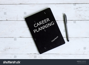 stock-photo-top-view-of-notebook-written-with-career-planning-with-pen-on-white-wooden-background-784389838[1]